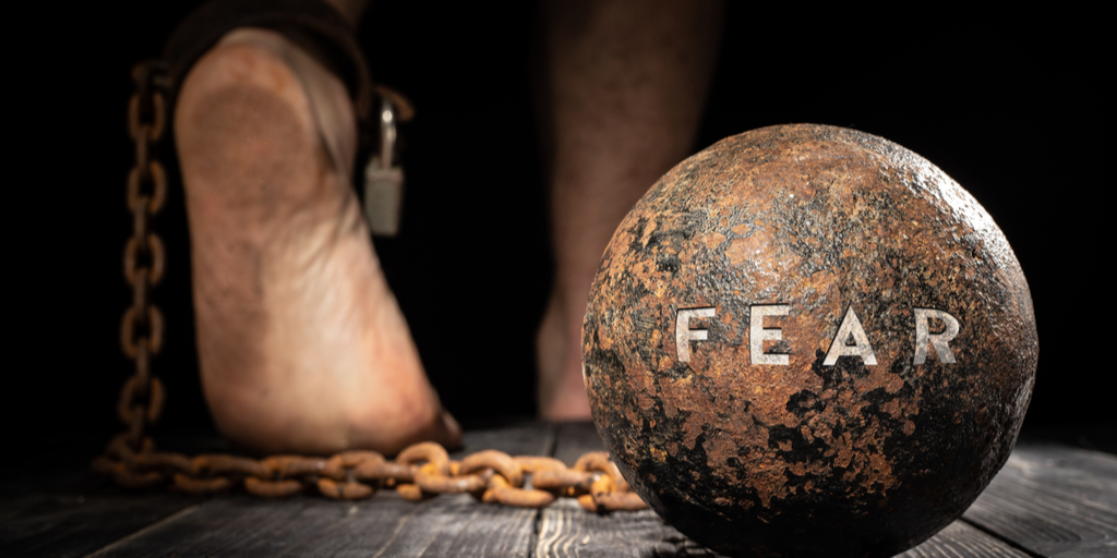 Ball and shackle with 'Fear' written on it