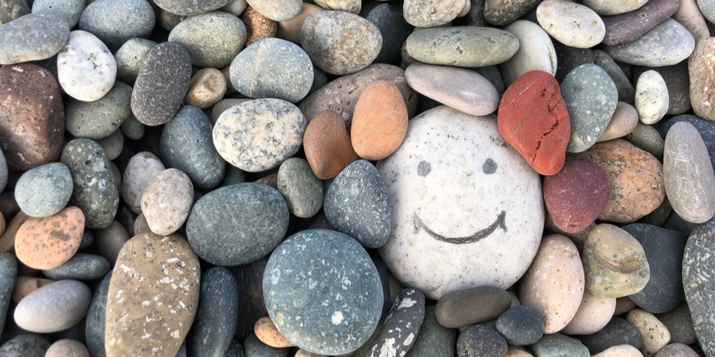 Pile of rocks with a smiling face drawn on one