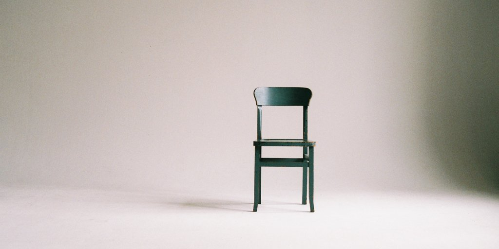 An empty chair in an empty room